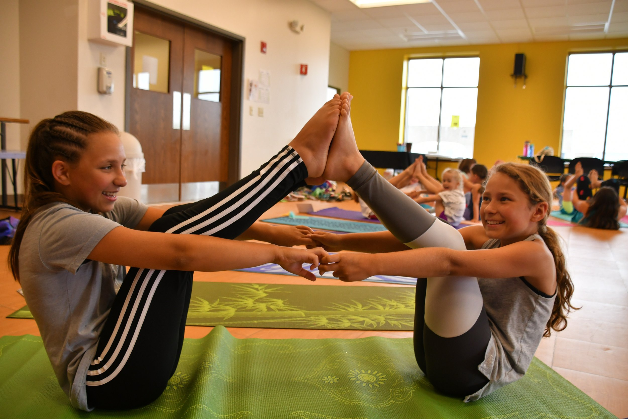 Boat pose two ways! Individual and as partners. Both work on core strength and always result in big smiles :)