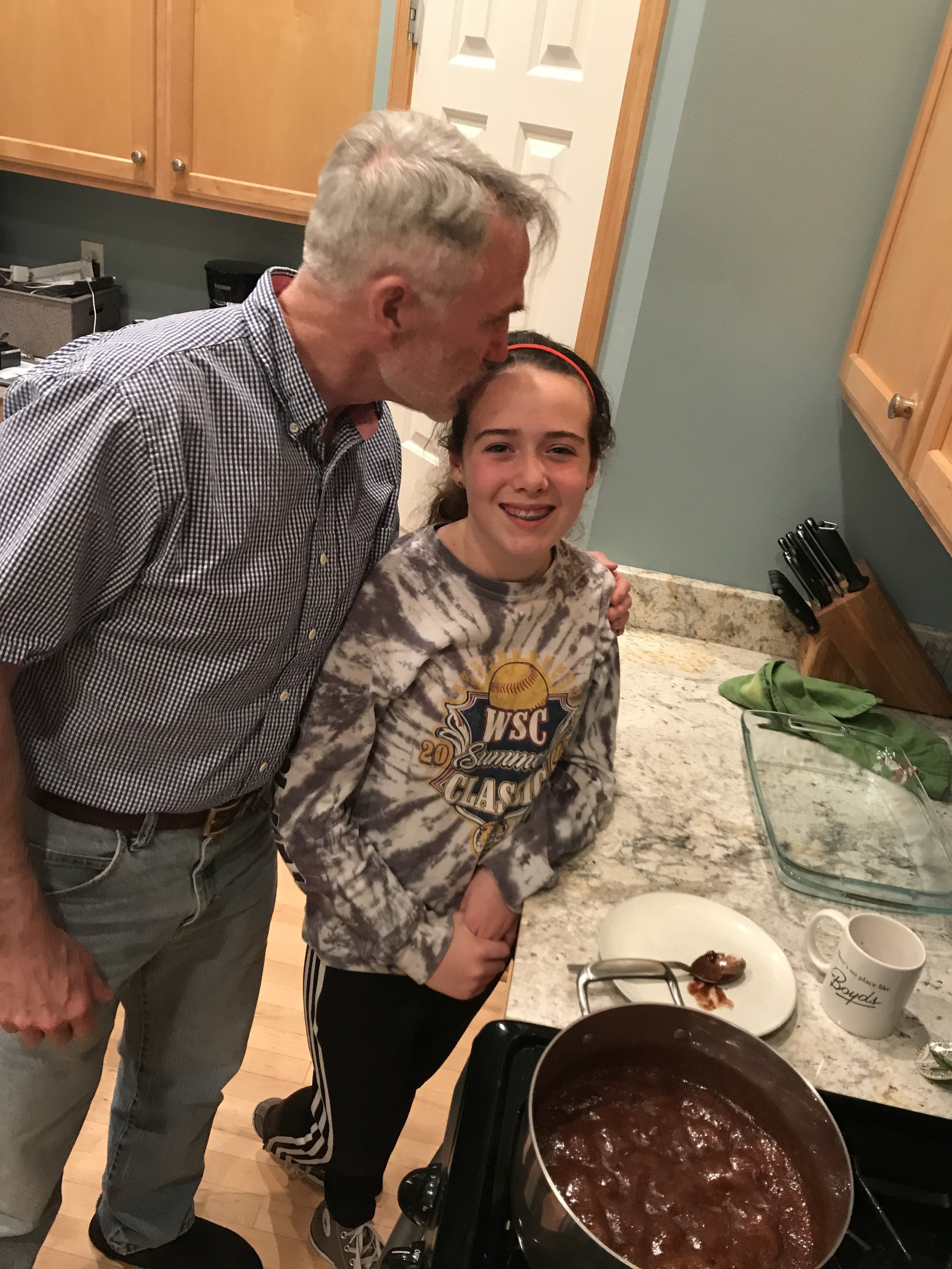 My dad teaching my daughter how to make his mom's fudge.