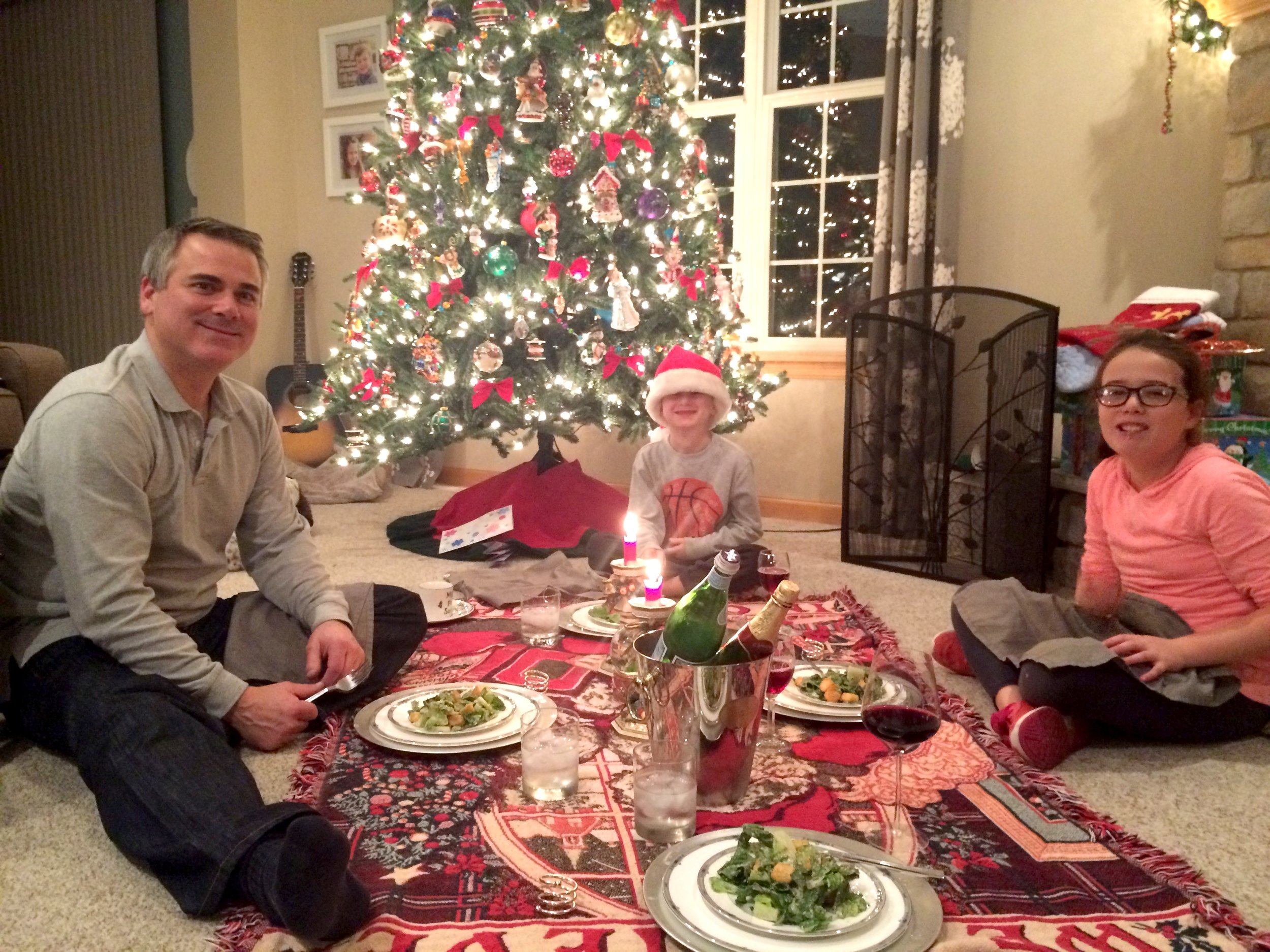 A Christmas picnic in front of the tree. On tonight's menu? Caesar salad and spaghetti. :)