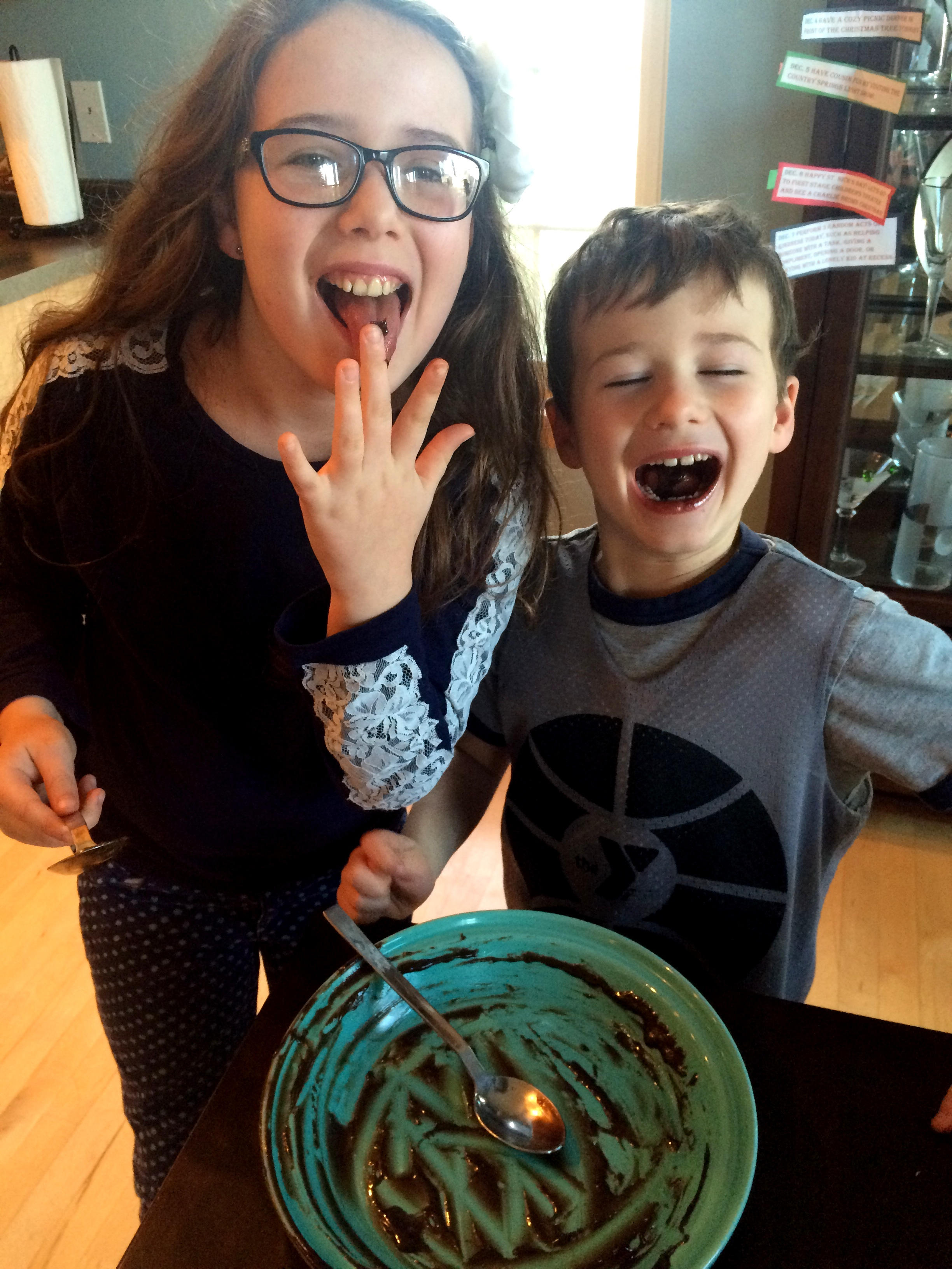 Not sure what they enjoy more…making the fudge or eating it.