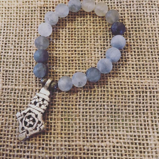 Another one!  Beautiful matte grey beads and a silver Ethiopian cross. $35...let us know if it would be perfect under your tree.