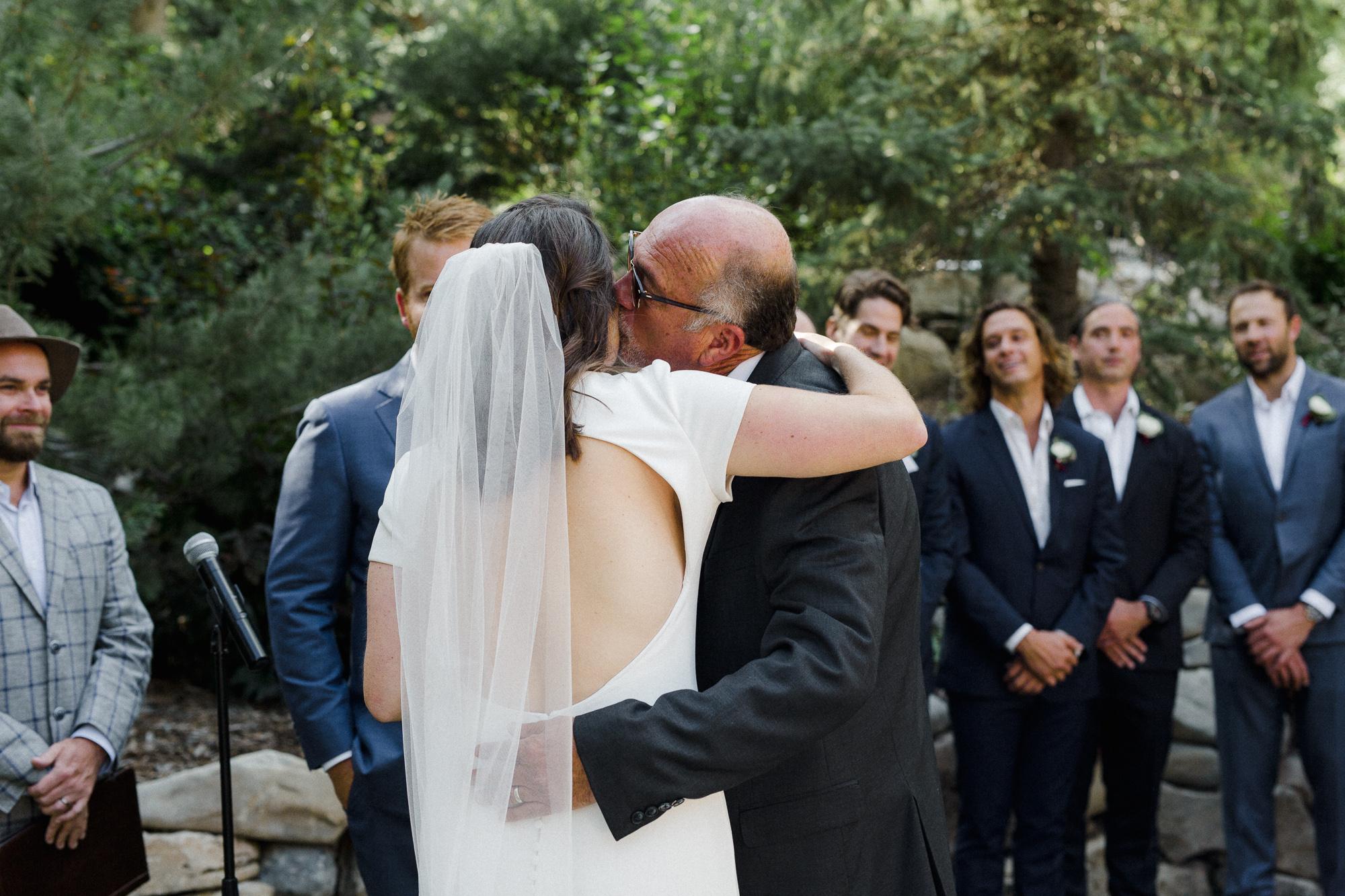 Bride kissing Dad.