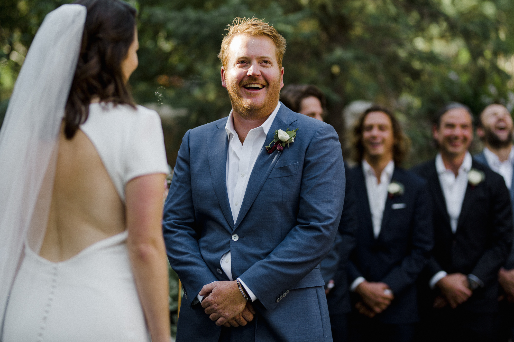 Groom Smiling at Ceremony.