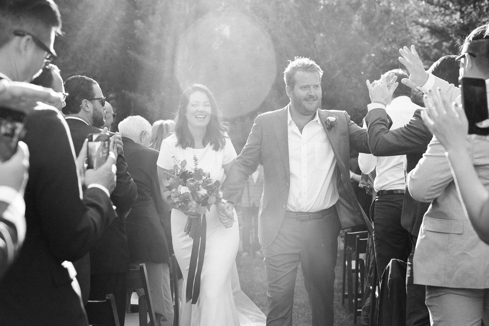 Bride and Groom Walking Down Isle.