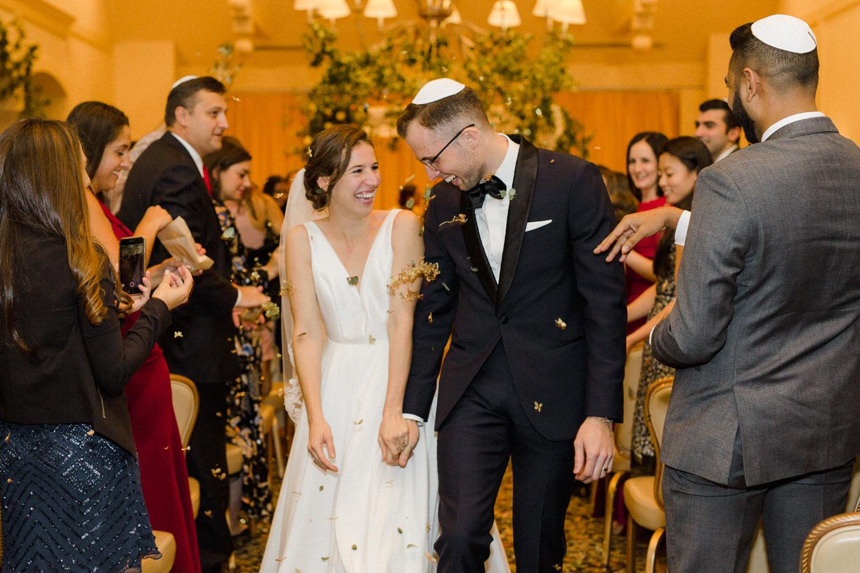 bride-and-groom-walking-down-isle