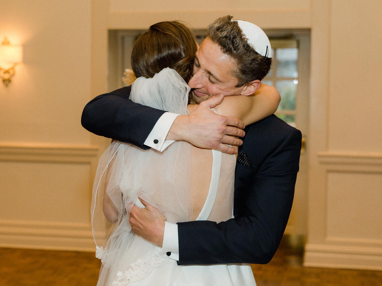 father-hugging-bride