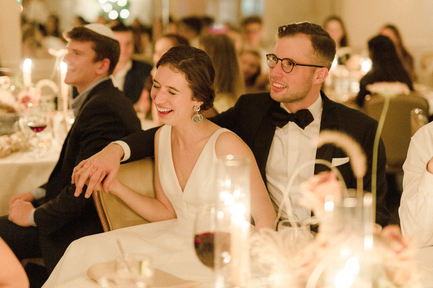 bride-and-groom-laughing-at-dinner
