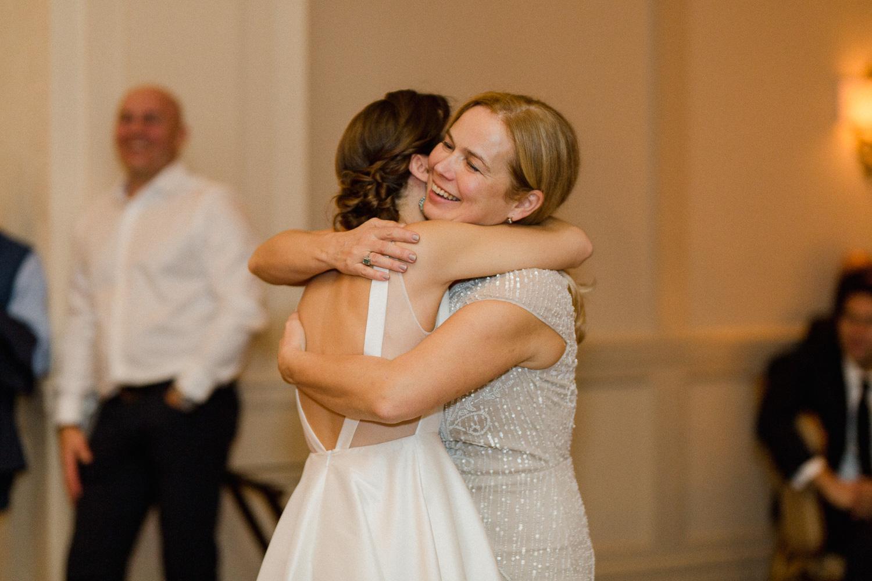 bride-hugging-mom-reception