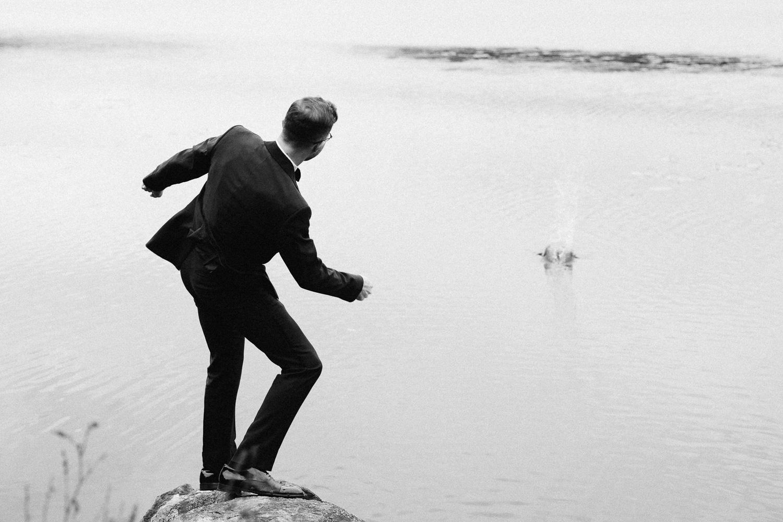 groom-skipping-rock