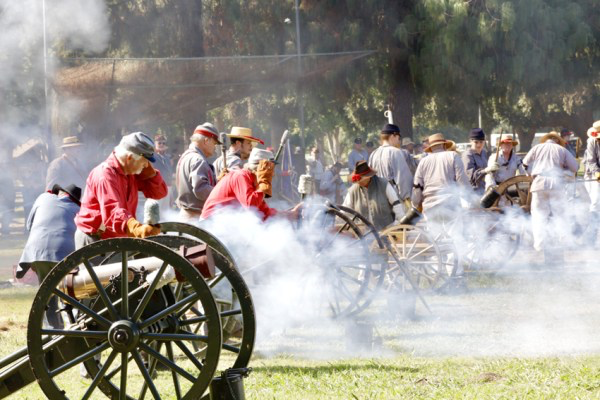 Re-enactment soldiers load and fire blank canon rounds to simulate a Civil War engagement.