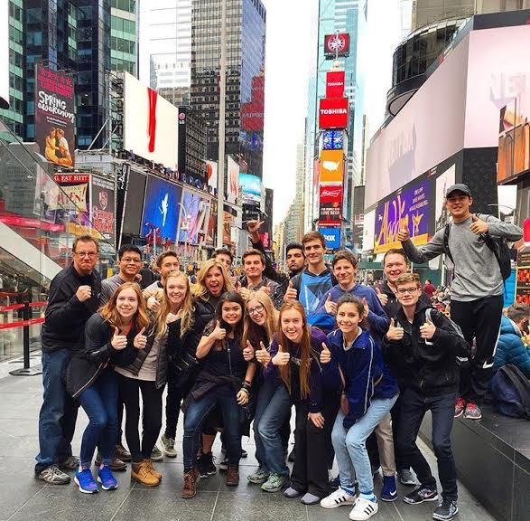 One of the first things The Feather staffers do in New York City each year is to pause to take in Times Square, including this 2016 group.