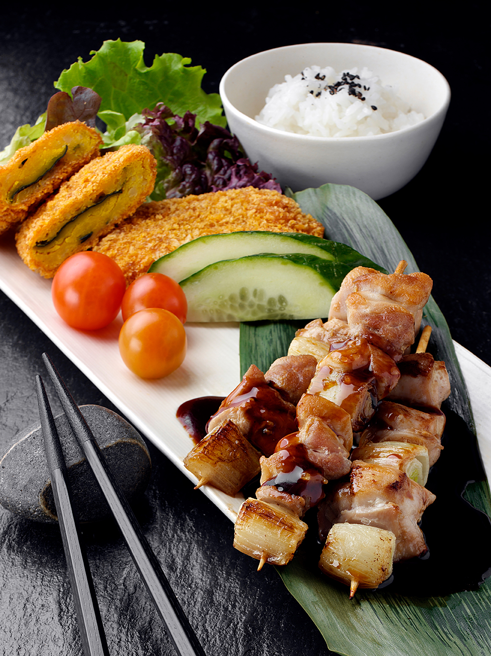 Japanese teriyaki chicken kebabs and rice