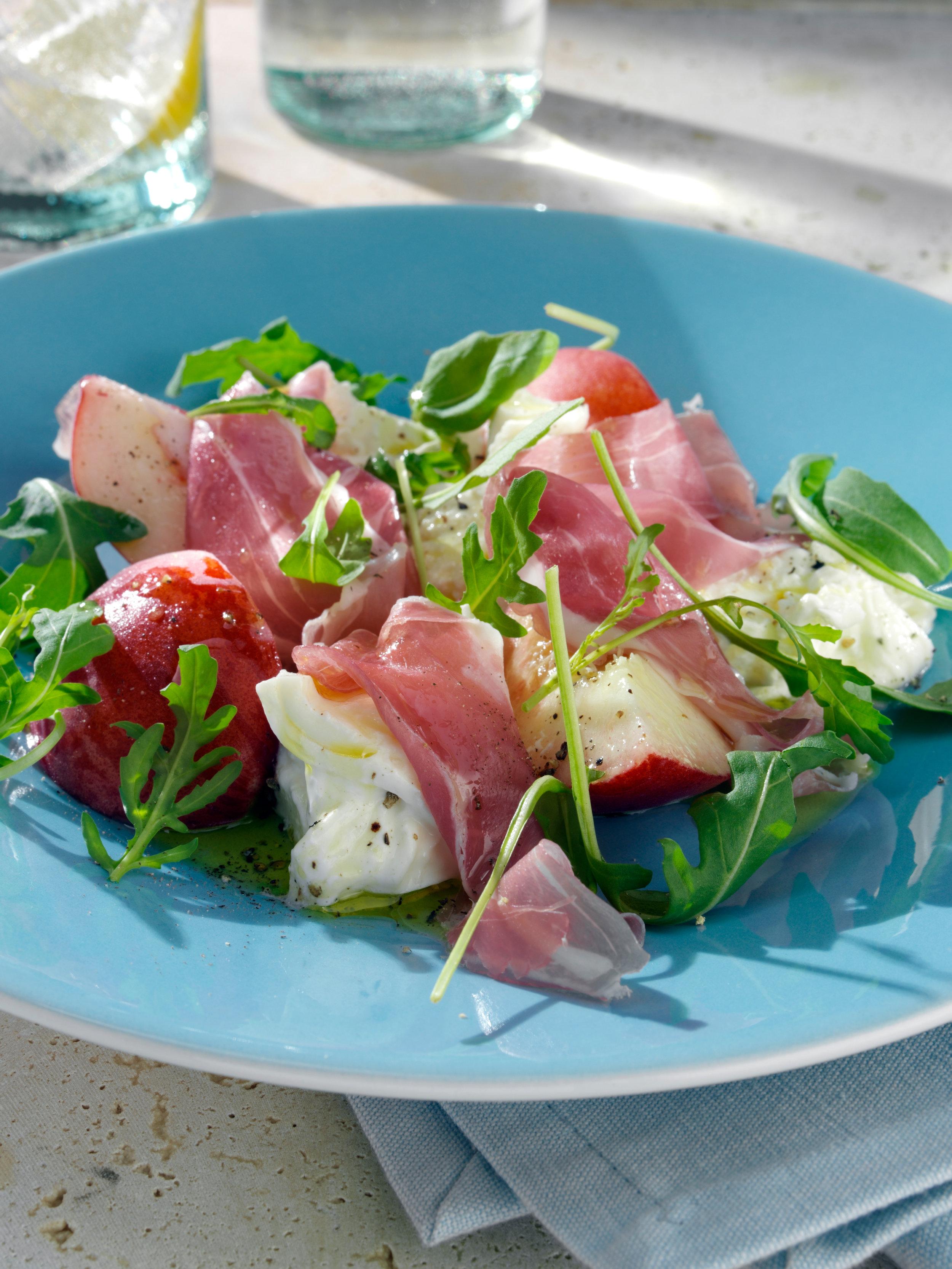 Summer salad of burrata, peaches and prosciutto