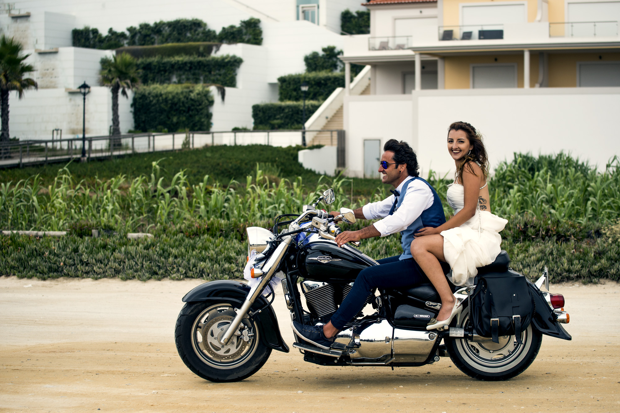 - The father of the bride took her to the ceremony on the back of his motorbike with a convoy of family cars behind beeping and waving in celebration as they went.