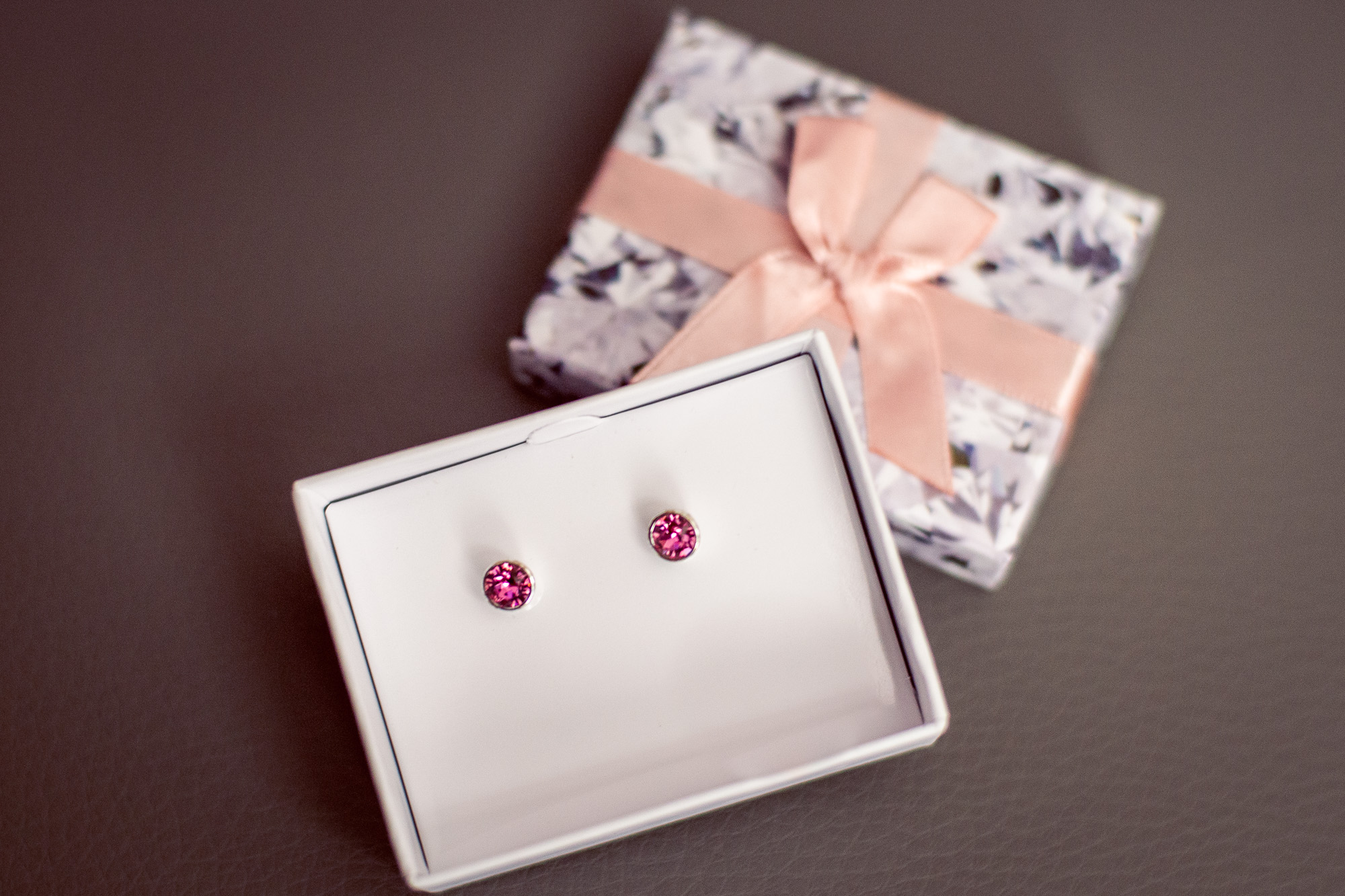 The bridemaids were gifted these pink gemstone earrings to match the soft pink theme. -