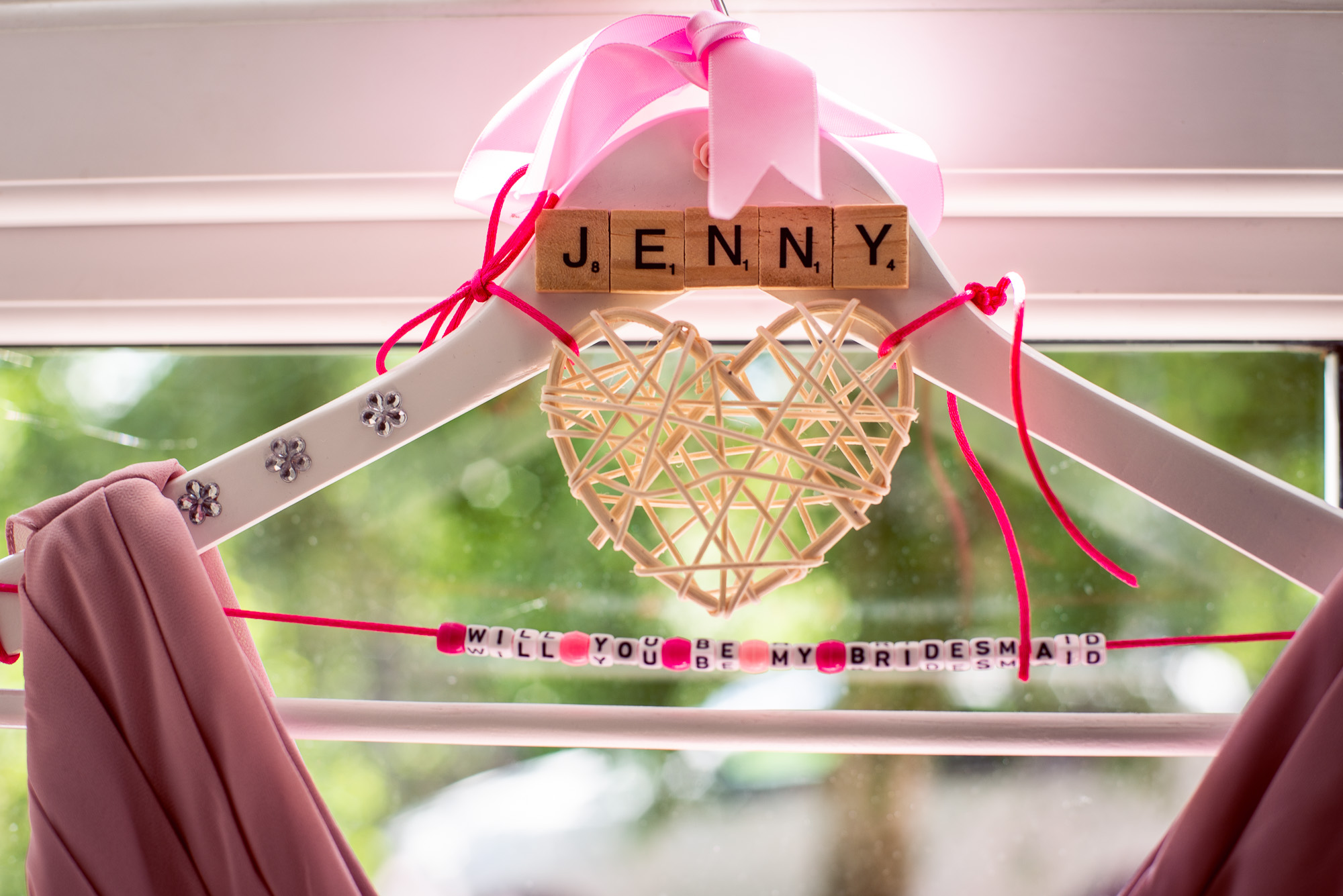 Carley is very creative & crafty so she made these hangers for all the bridemaids dresses… -