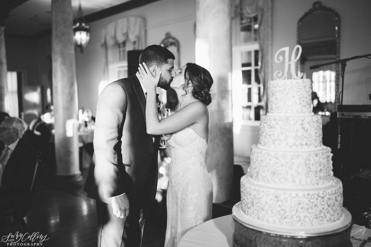 poses, indoor, romantic, spring, light and airy, natural light, ideas, passion, artistic, creative, inspiration, editorial, art, lighting, love, Knoxville, Tennessee, Cherokee country club, vibrant, colorful, bright, cake, bride, groom, kiss, reception