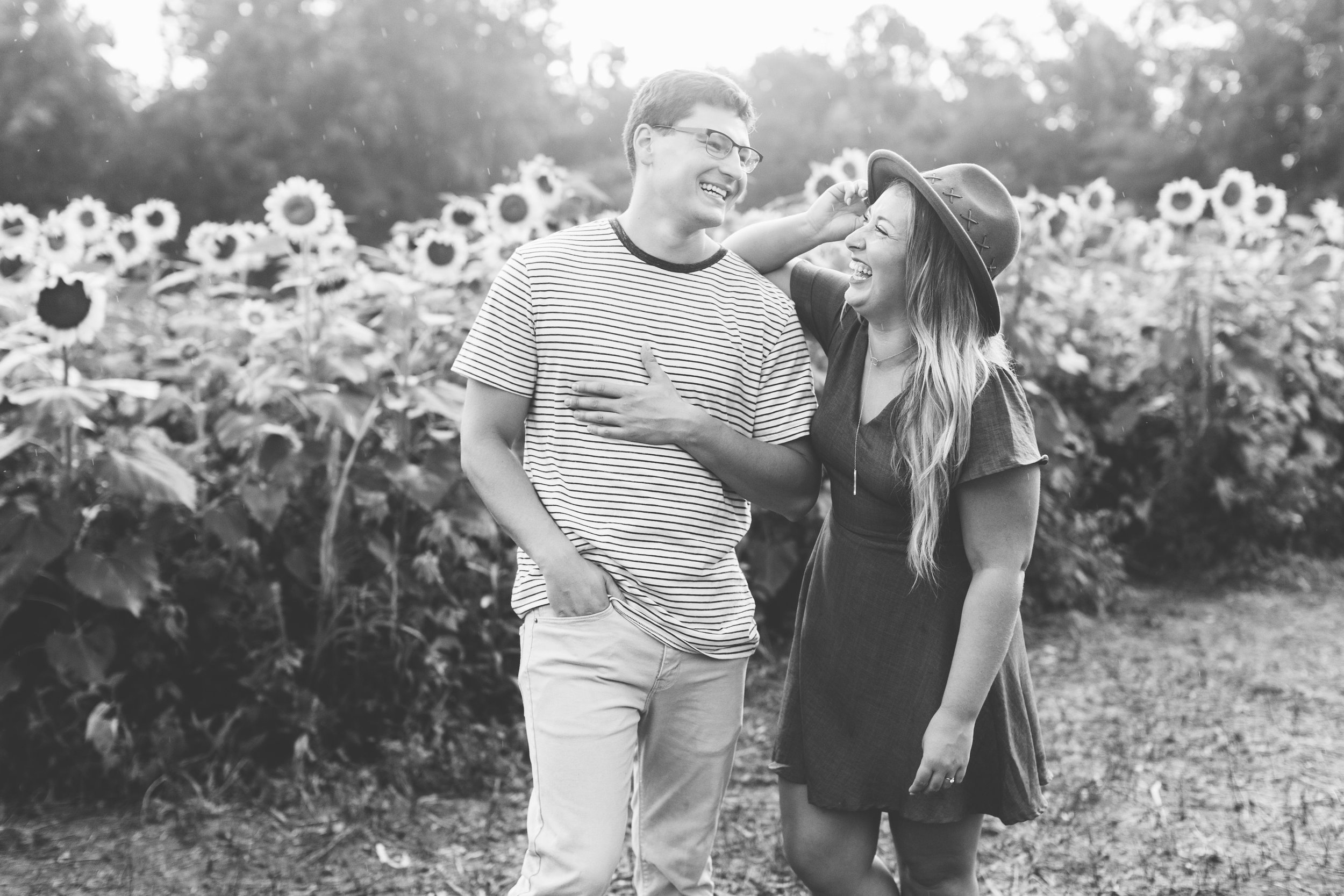 Fun sunflower engagement by Suzy Collins Photography