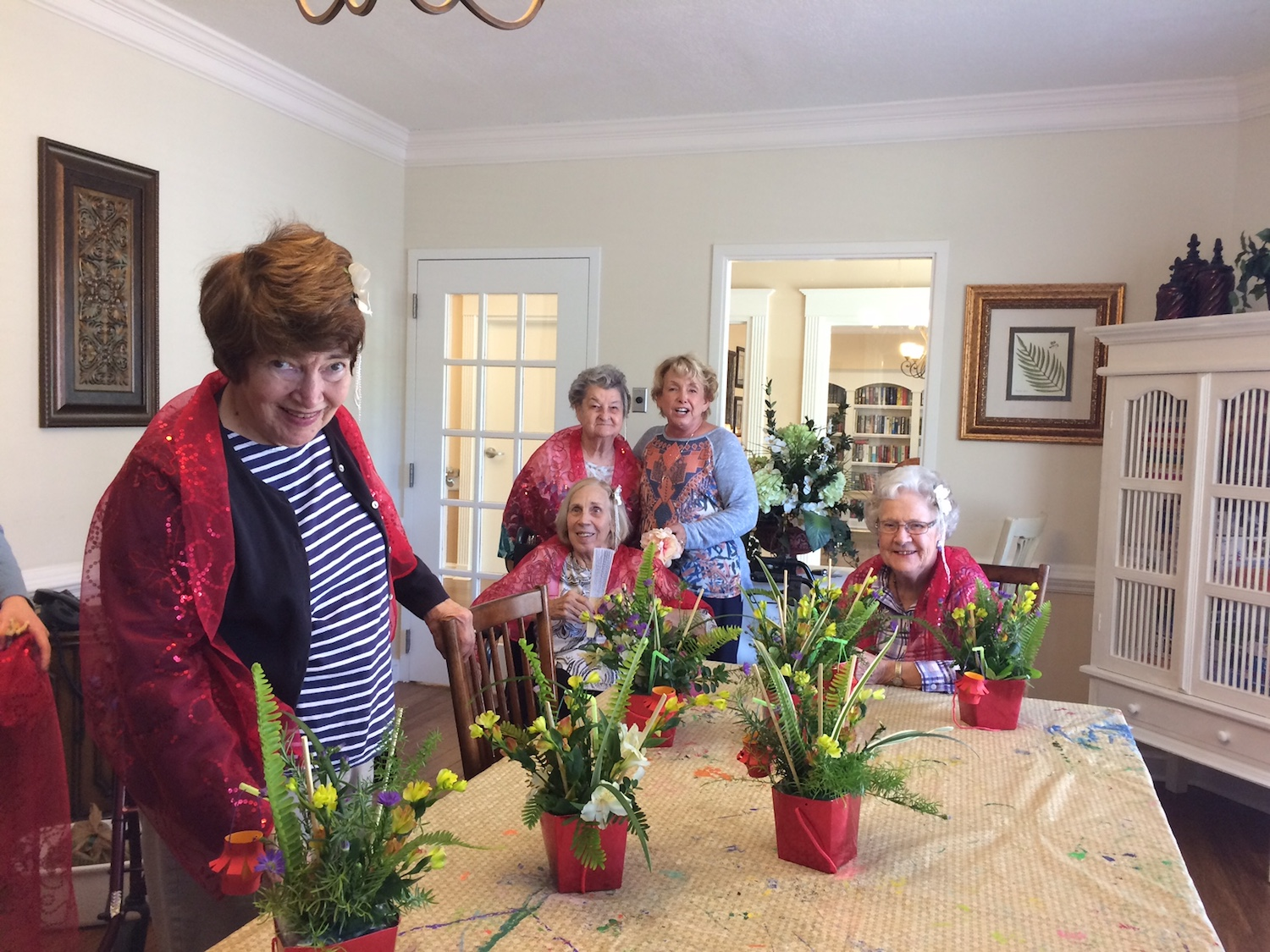 Member Alice Caldwell helps residents prepare centerpieces for the dining room
