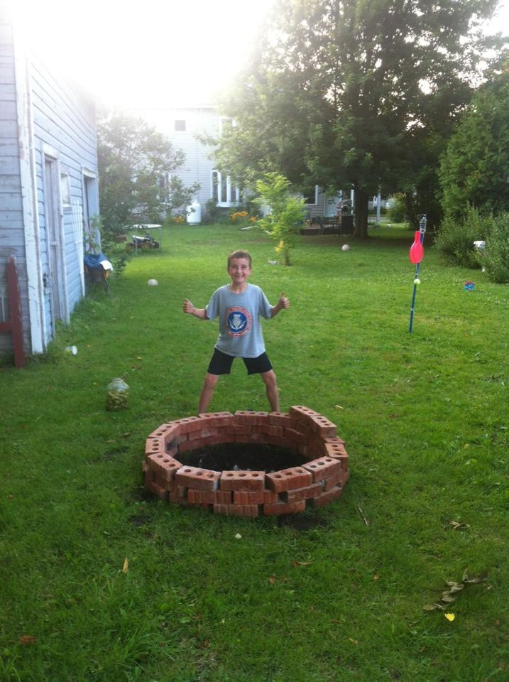 Travis A. sends a photo of his son celebrating a completed firepit.