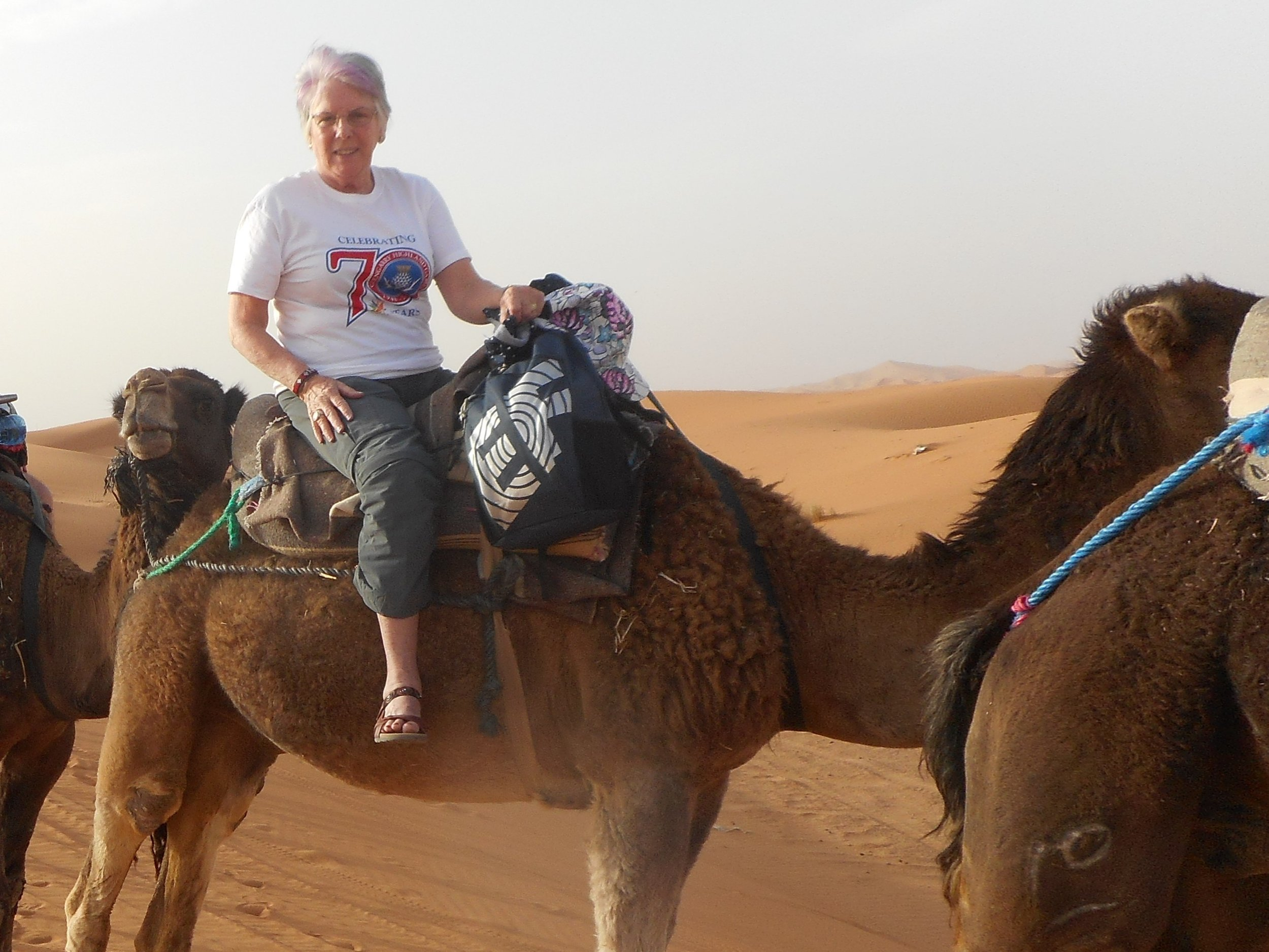 Judith MacLeod camel riding in the Sahara in Morocco