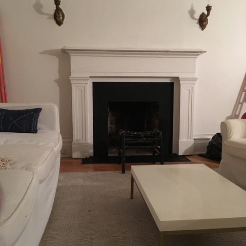 after flat black paint on the surround and hearth.jpeg