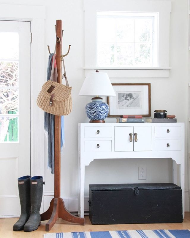 A back entry ready for adventure, rain or shine. In a previous home I threw an old, weathered chest beneath a pretty console. I always love the mix of old and new, and this time it meant double the function with extra storage for scarves, mittens, and everything you need to brave the elements in NS 📷: @samsonpix ⁣ ⁣ #debnelsondesign⁣ #howyouhome⁣ #inmydomaine⁣ #smmakelifebeautiful ⁣ #finditstyleit⁣ #halifaxnoiseathome