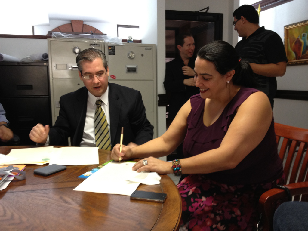 The former property owners signing the deed.