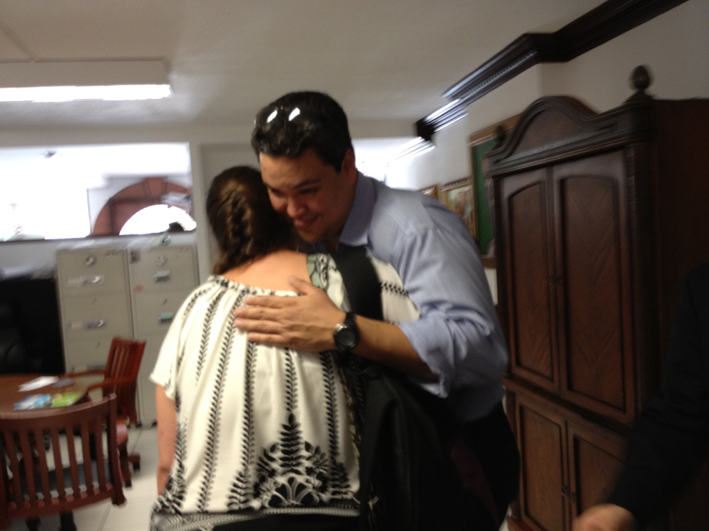 A hug from Mario, the building's former owner, to end the meeting.
