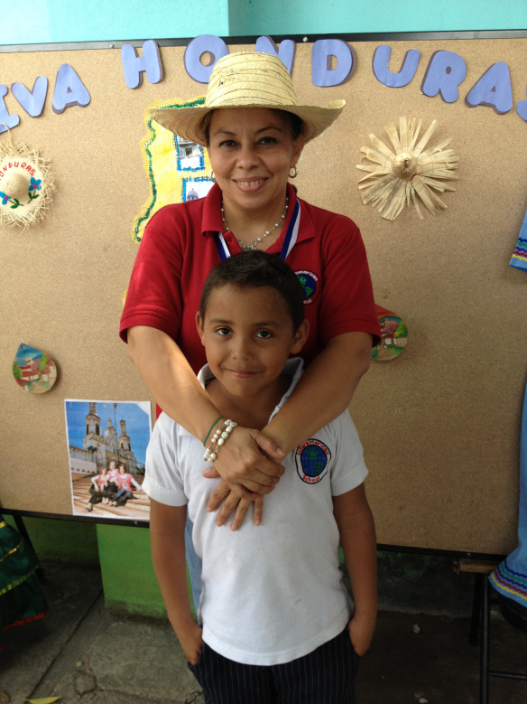 Jonatan and his teacher at the school's Honduran festival.