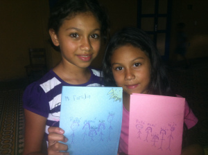 Two beautiful girls and the drawings they made during Sunday School class