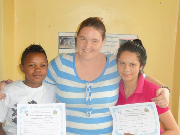 Sara (right) with Escarleth and Amber after completing her barber training program