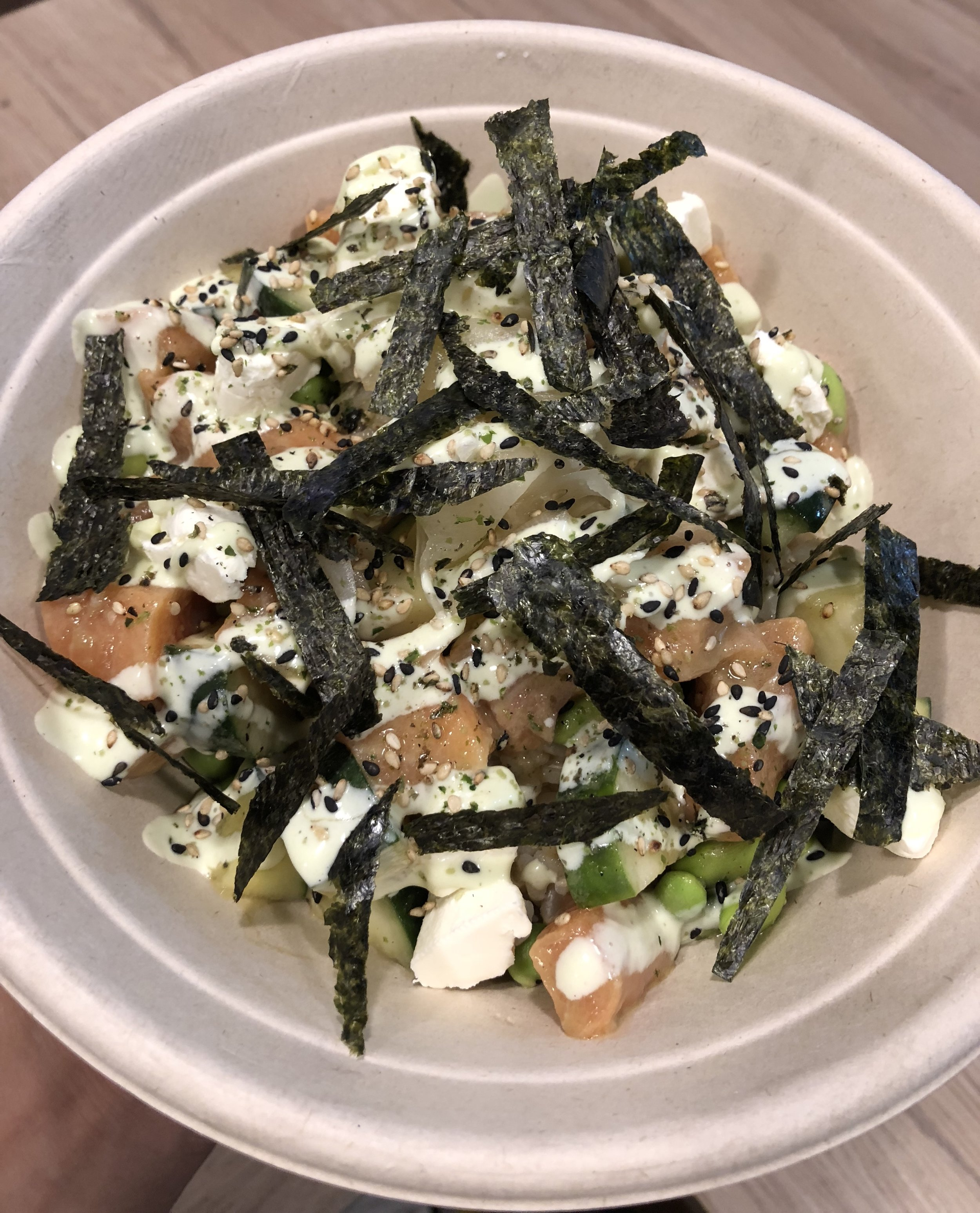 GATEWAY   SALMON mixed with CUCUMBER, EDAMAME;  marinated in WASABI PONZU;  topped with PICKLED GINGER, CREAM CHEESE, FURIKAKE, NORI;  with WASABI MAYO drizzle.