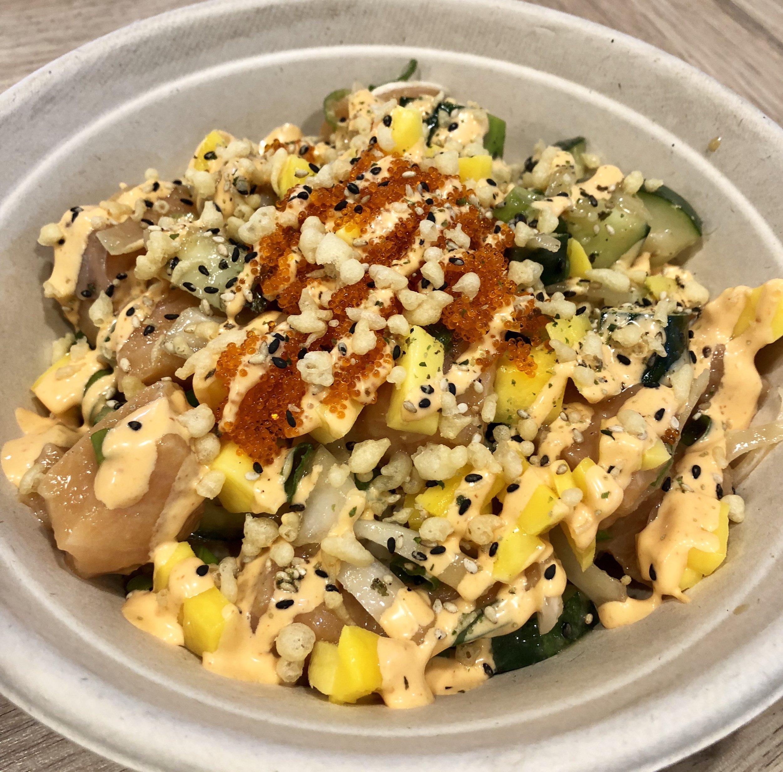 SRIRACHA MAYO   SALMON mixed with CUCUMBER, ONIONS, SCALLIONS, MANGO;  marinated in CITRUS, SPICY, GARLIC or GINGER PONZU;  topped with TOBIKO, FURIKAKE, TEMPURA CRISPS;  with SRIRACHA MAYO drizzle.