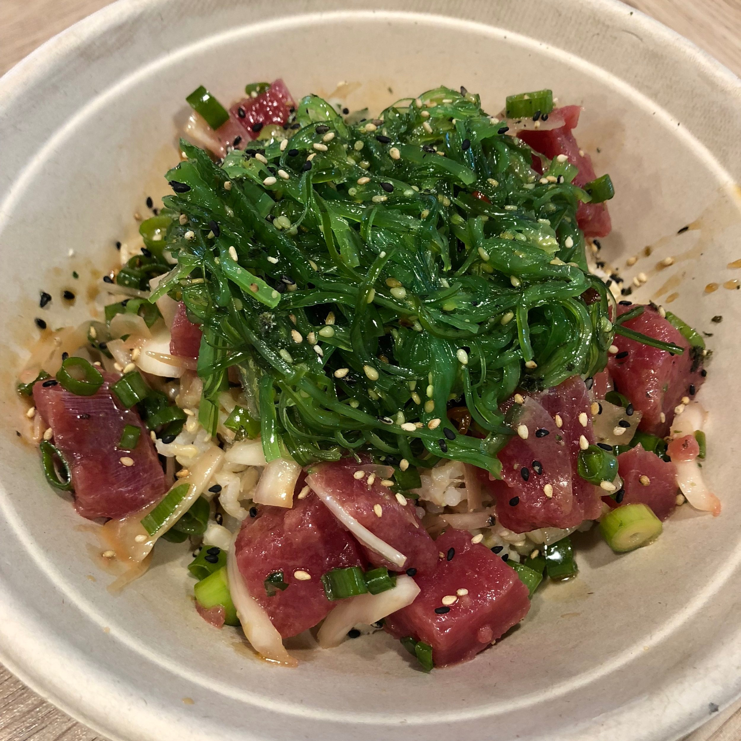 CLASSIC SHOYU  TUNA mixed with SCALLIONS, ONIONS;  marinated in CITRUS, SPICY, GARLIC or GINGER PONZU;  topped with SEAWEED SALAD, FURIKAKE.