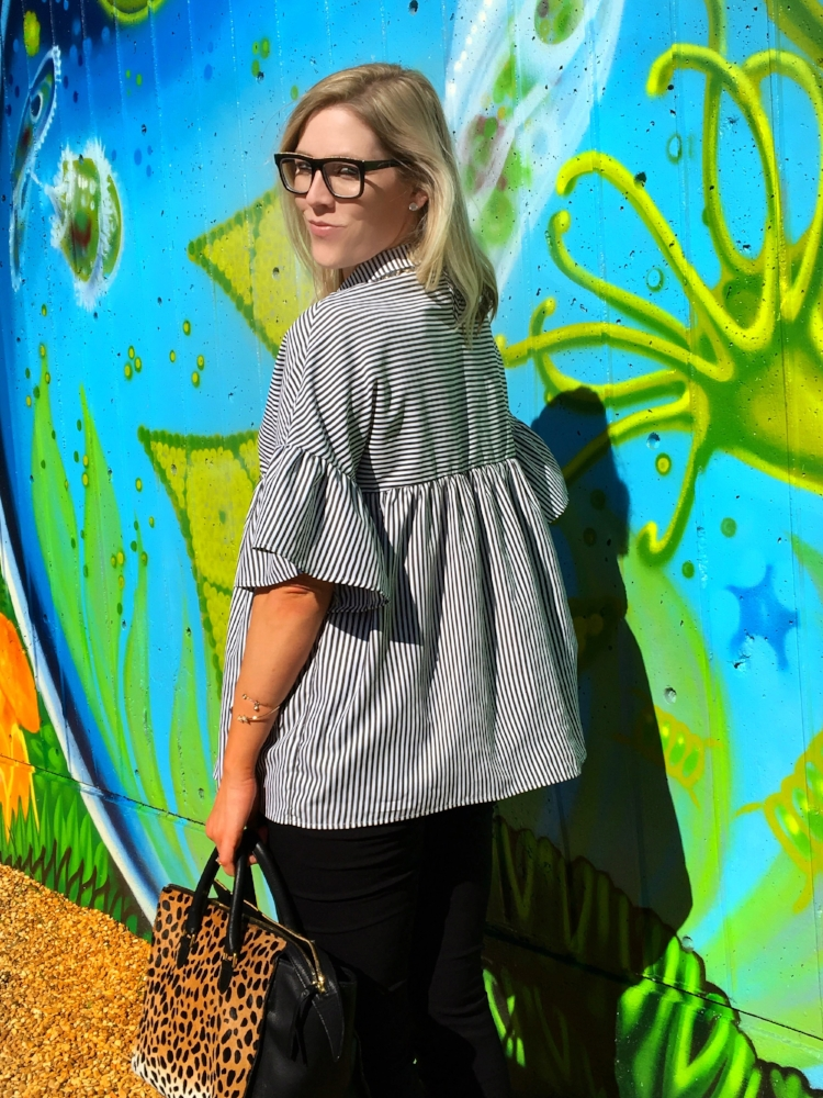 We paired the Black and White Striped Ruffled Baby Doll top from SheInside with black skinnies from the Who What Wear collection at Target, the Clare V Leopard print Sandrine bag from Rent the Runway Unlimited and our Stella McCartney Rims from Shop Ditto.