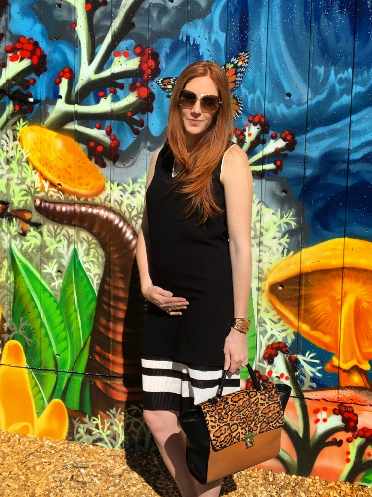 Kimberly looking so fabulous with her baby bump in Vince.