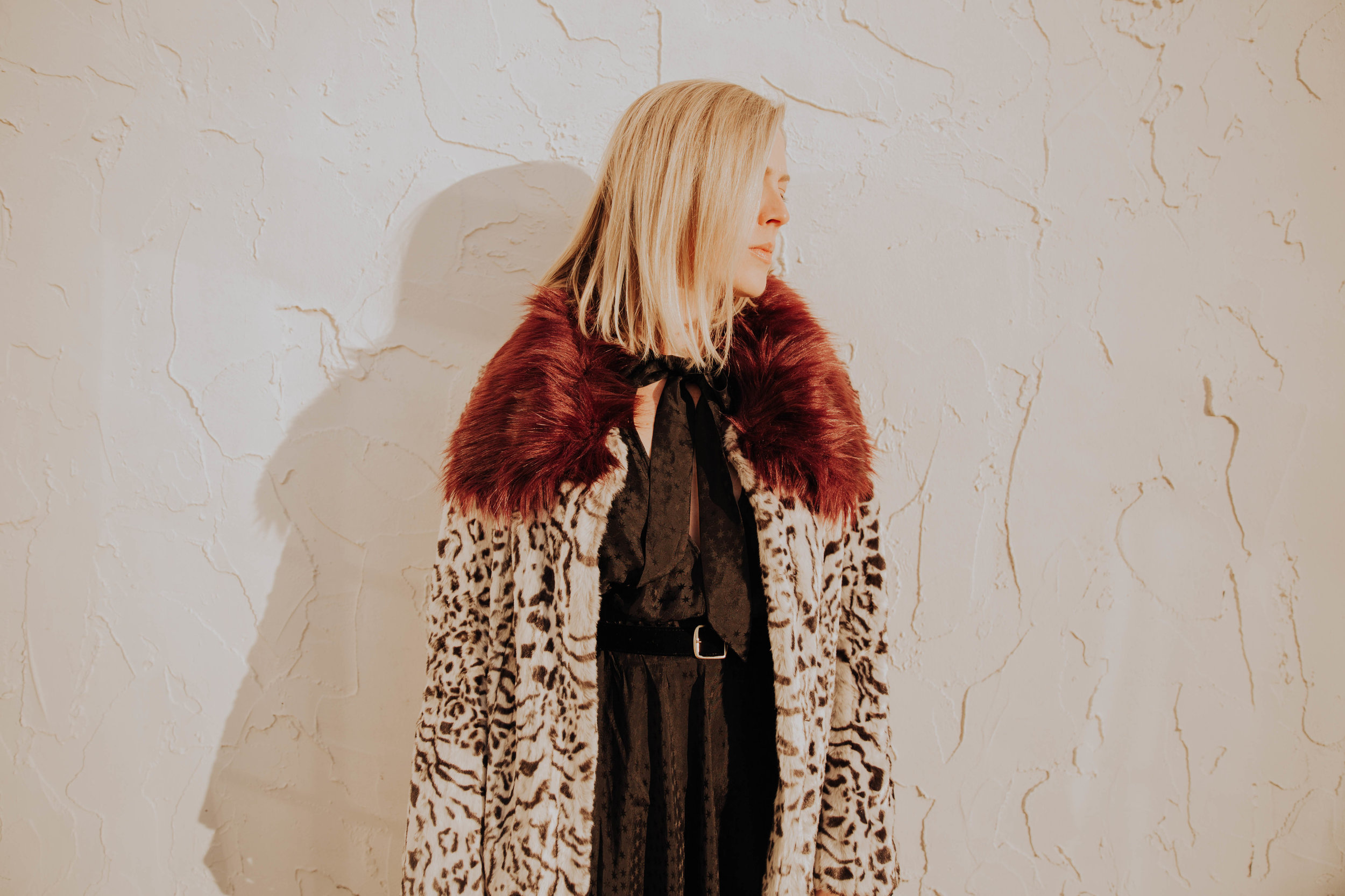 The Borrowed Babes Fashion Blogger Stephanie Mack Kearney wearing Unreal Fur Coat and Philosophy di Lorenzo Serafini from Rent the Runway