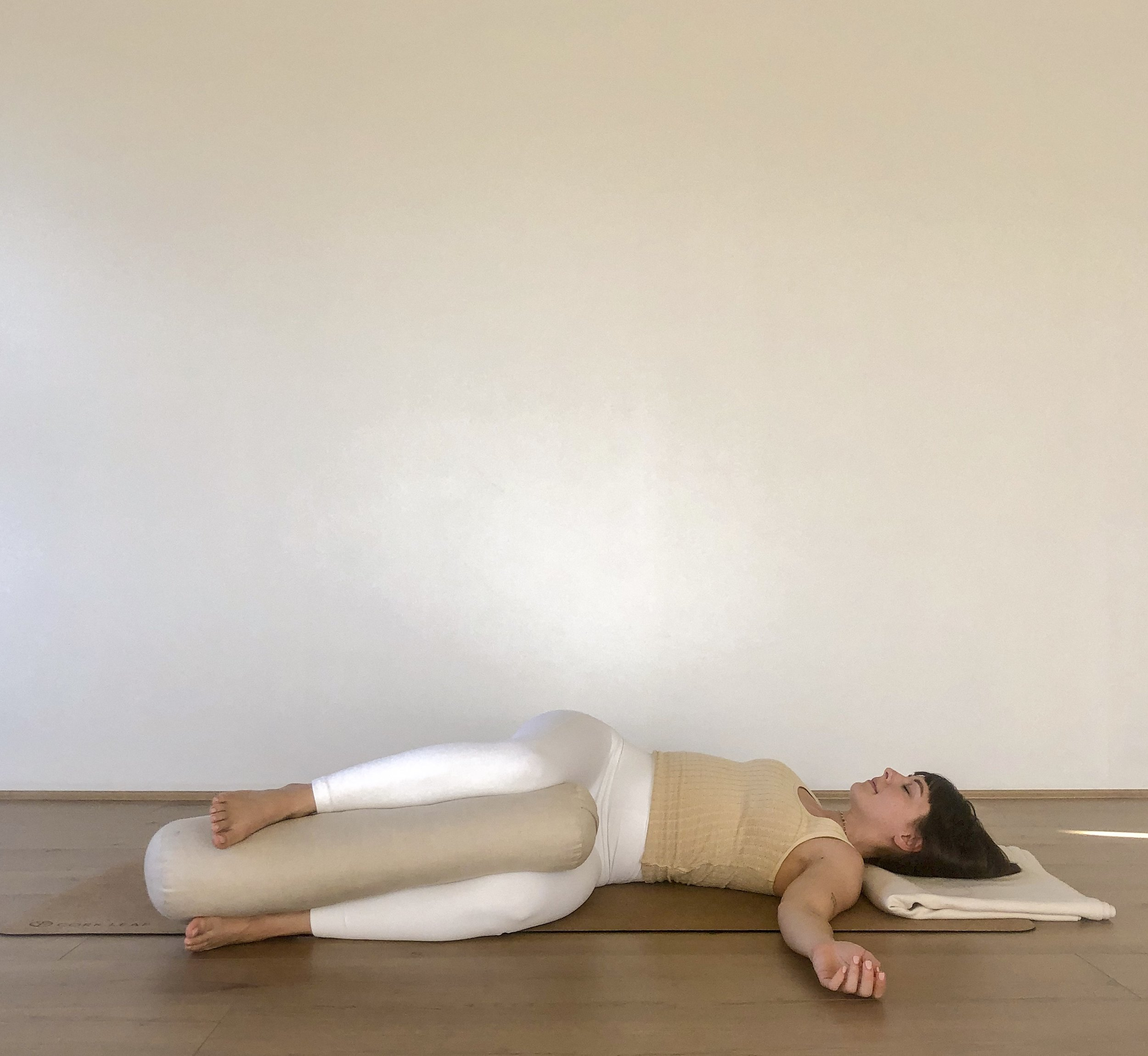 Supine Twist with Lower Body Stabilized