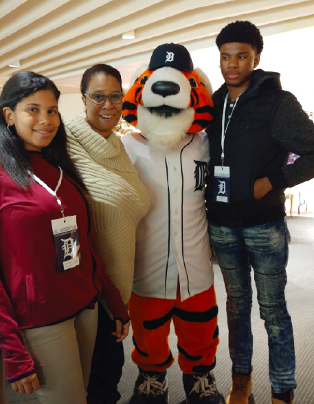 Renee Avery attending a Detroit Tigers game with her children .
