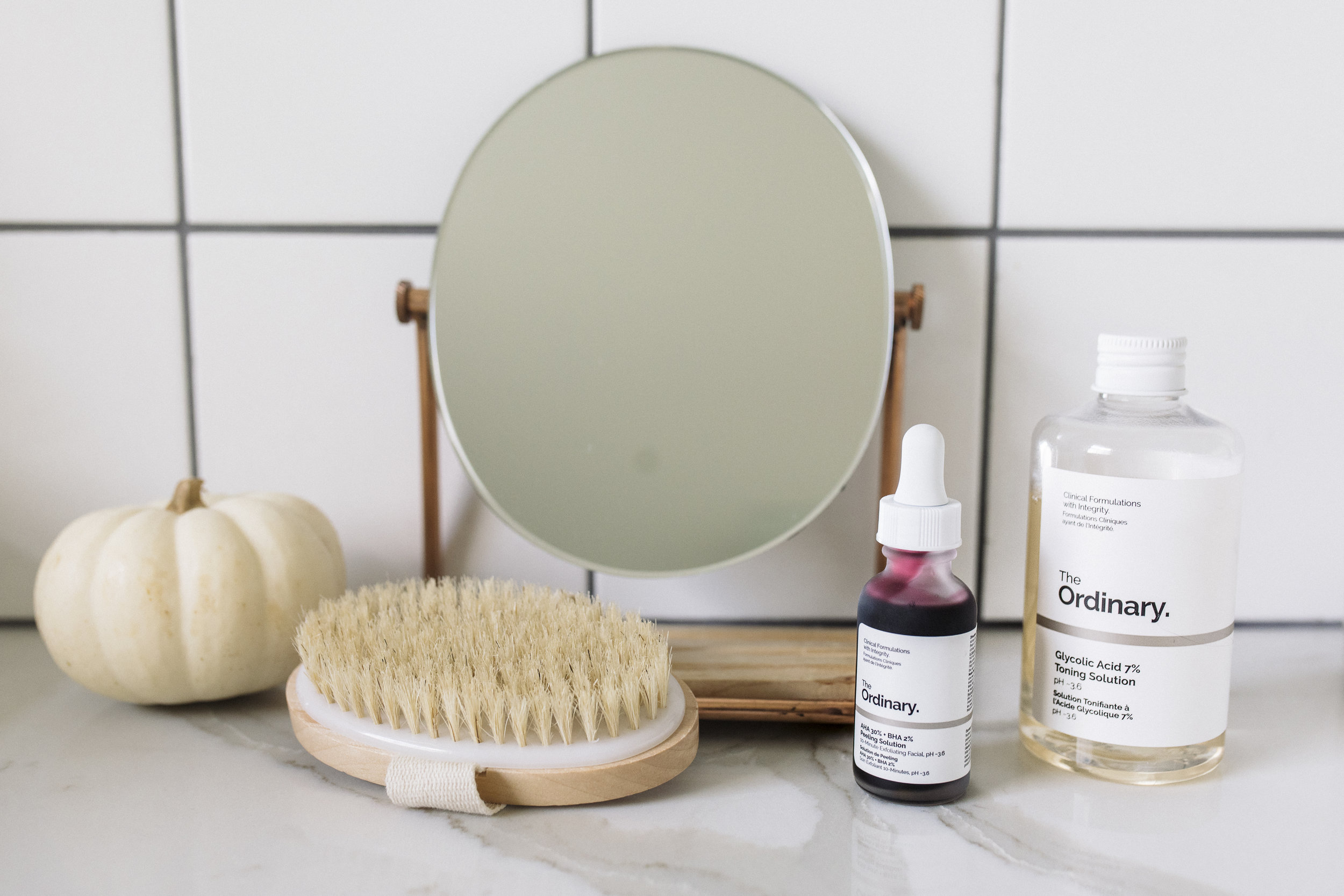 bathroom mirror with skin care products to keep skin glowing all year round, and especially during the cold fall season