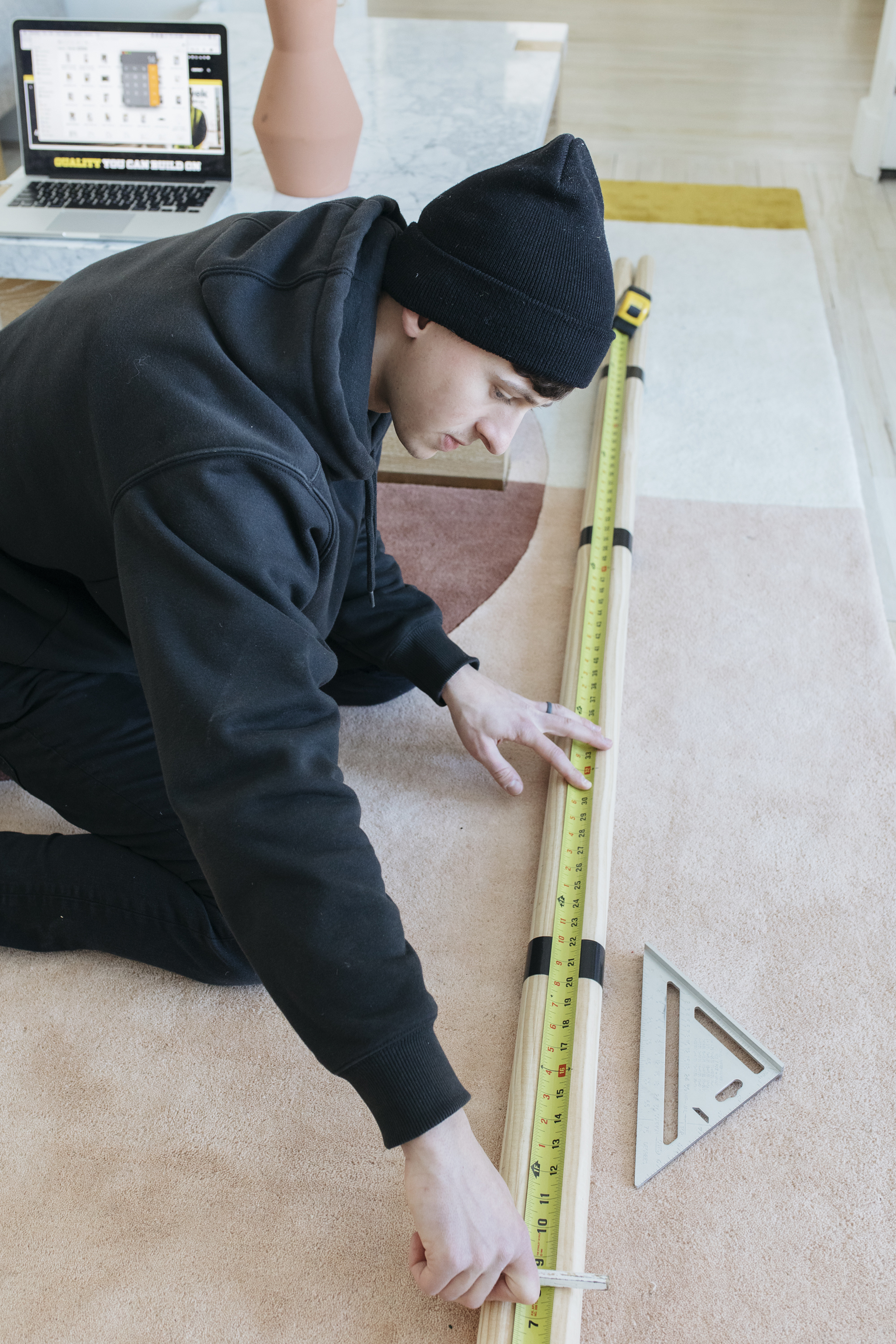 Justin helping measure the dowels for the dowel ladder that we did ourselves. it is so easy to diy a ladder!
