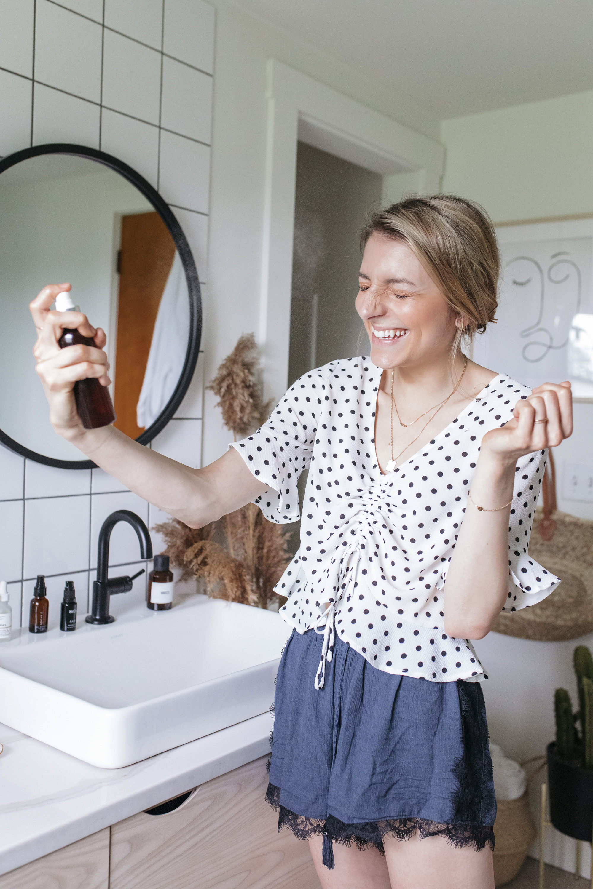 Creative blogger Emily r hess shares the secrets behind her skincare routine such as a hydrating hyaluronic acid mist to keep her skin fresh