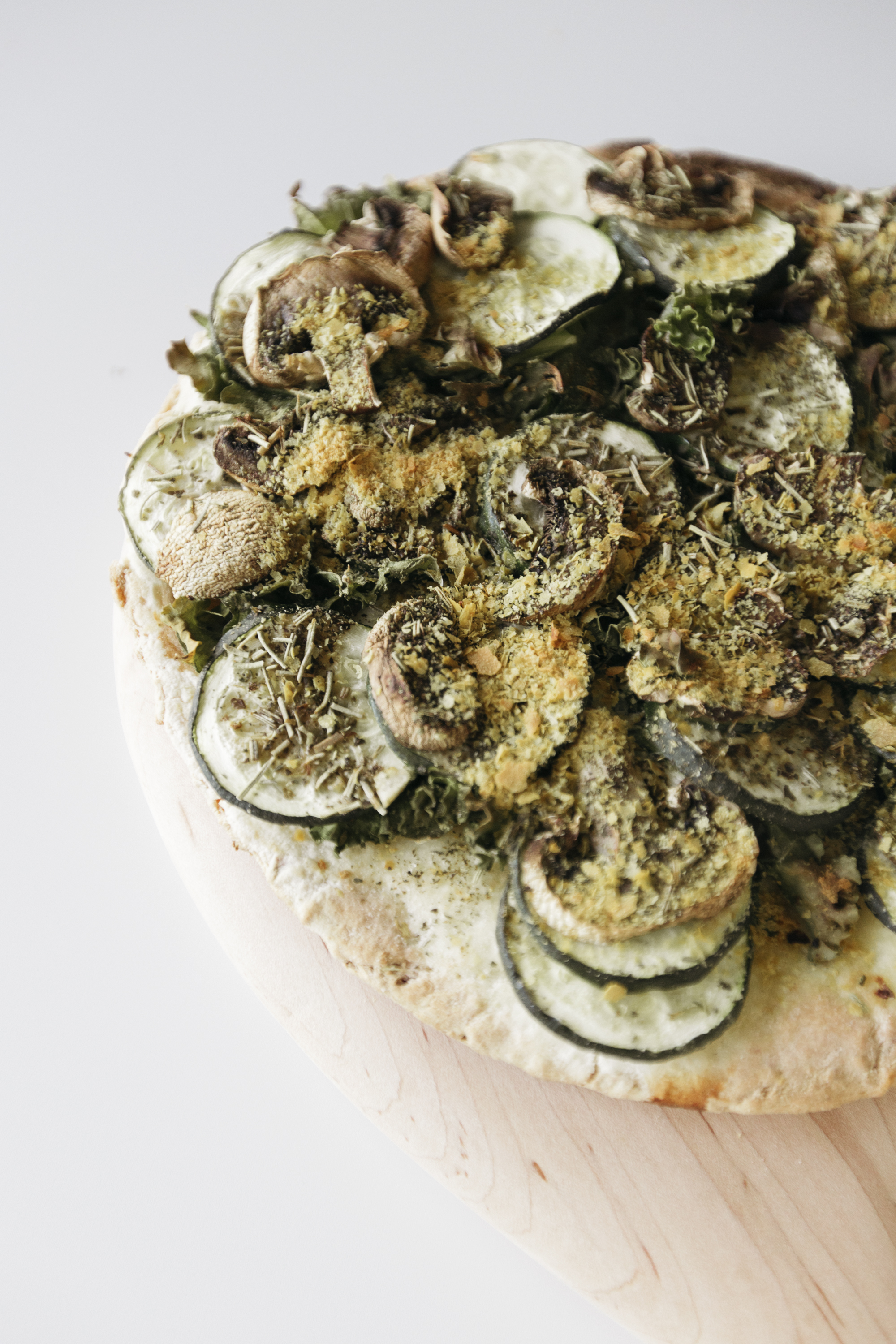 Delicious gluten free, dairy free, and vegan avocado toast pizza recipe created by creative lifestyle blogger and founder of luca creative co Emily R hess.