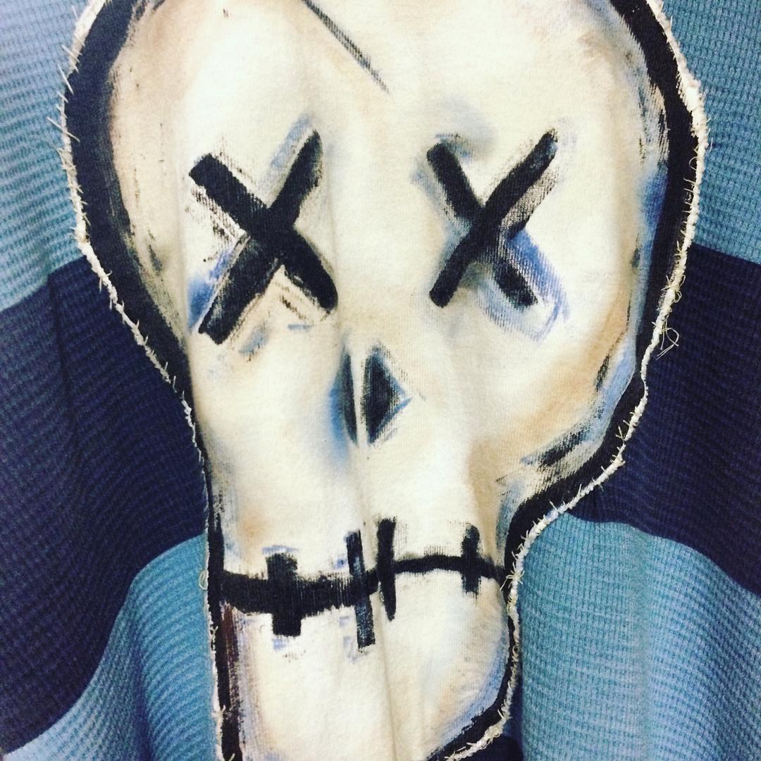 Close up of Creature's blue shirt
