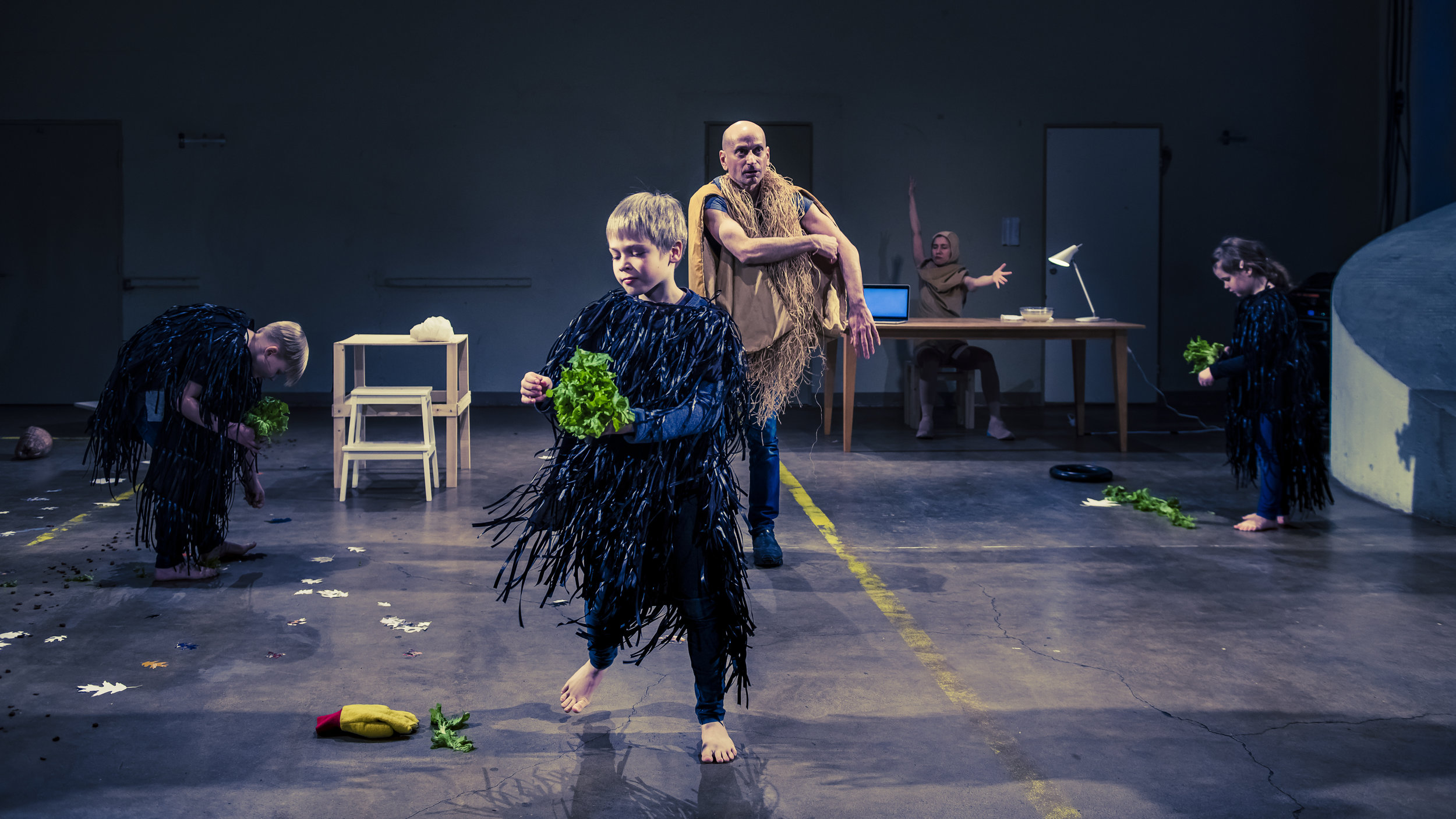 Photo by Saara Autere.  Scarecrow  (2018) by  Every house has a door , directed by Lin Hixson, performed at Mad House, Helsinki, Finland. Pictured left to right: Ahti Leppänen, Colin Hunter, Matthew Goulish, Essi Kausalainen, Emelie Hunter.