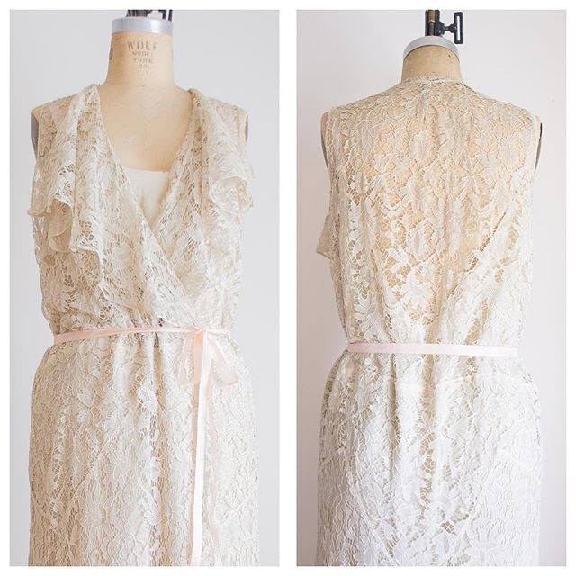 1930s lace bias cut wedding dress just listed! I can't decide which I love more--the ruffled wrap front or the illusion low back! Size medium/large US size 10-14. Link in the bio.