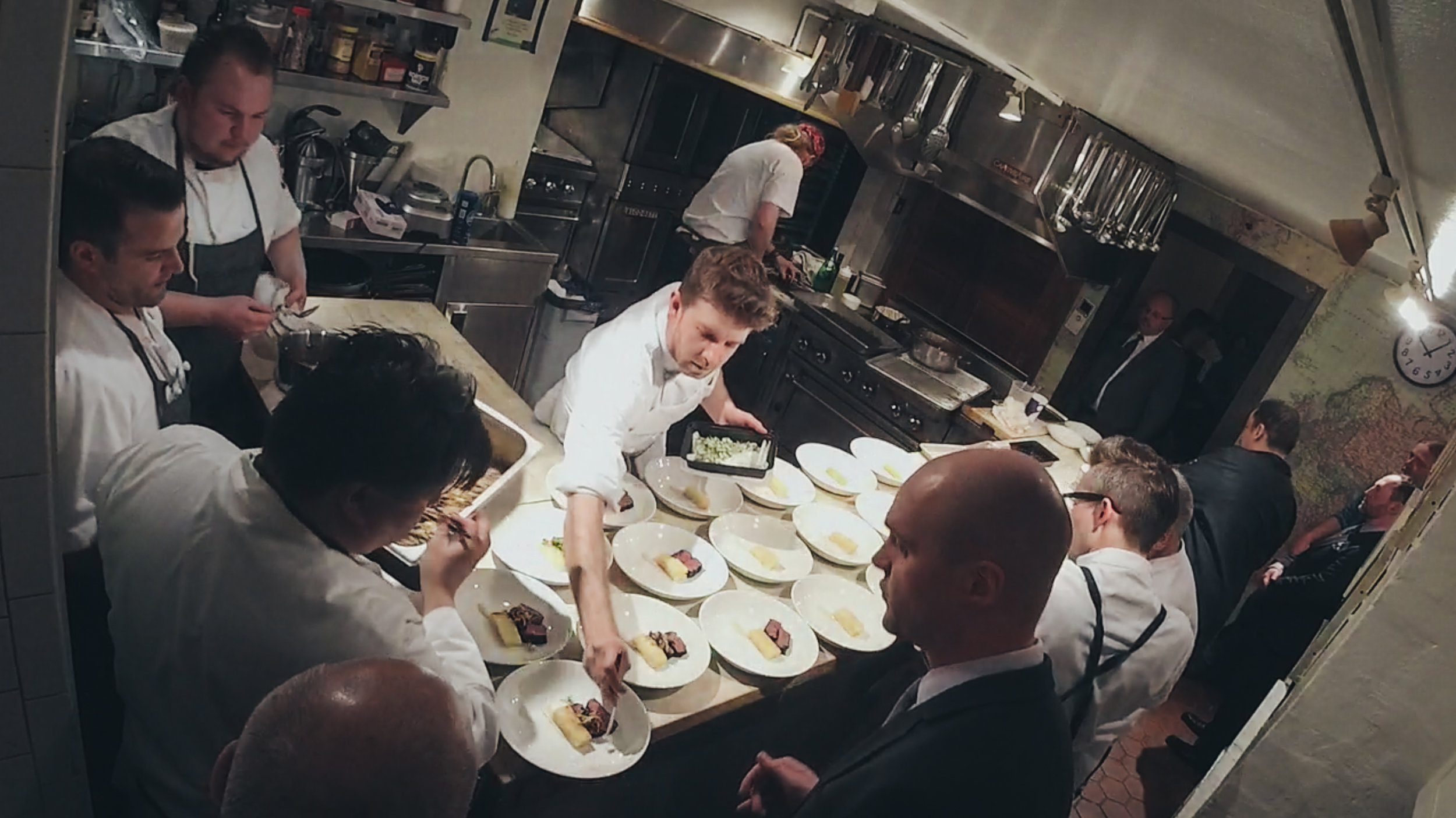 Plating at the James Beard House with 2-Michelin Star Chef Ryan McCaskey of Acadia and his team. Getting 75+ plates out at the same time is a test of efficiency.