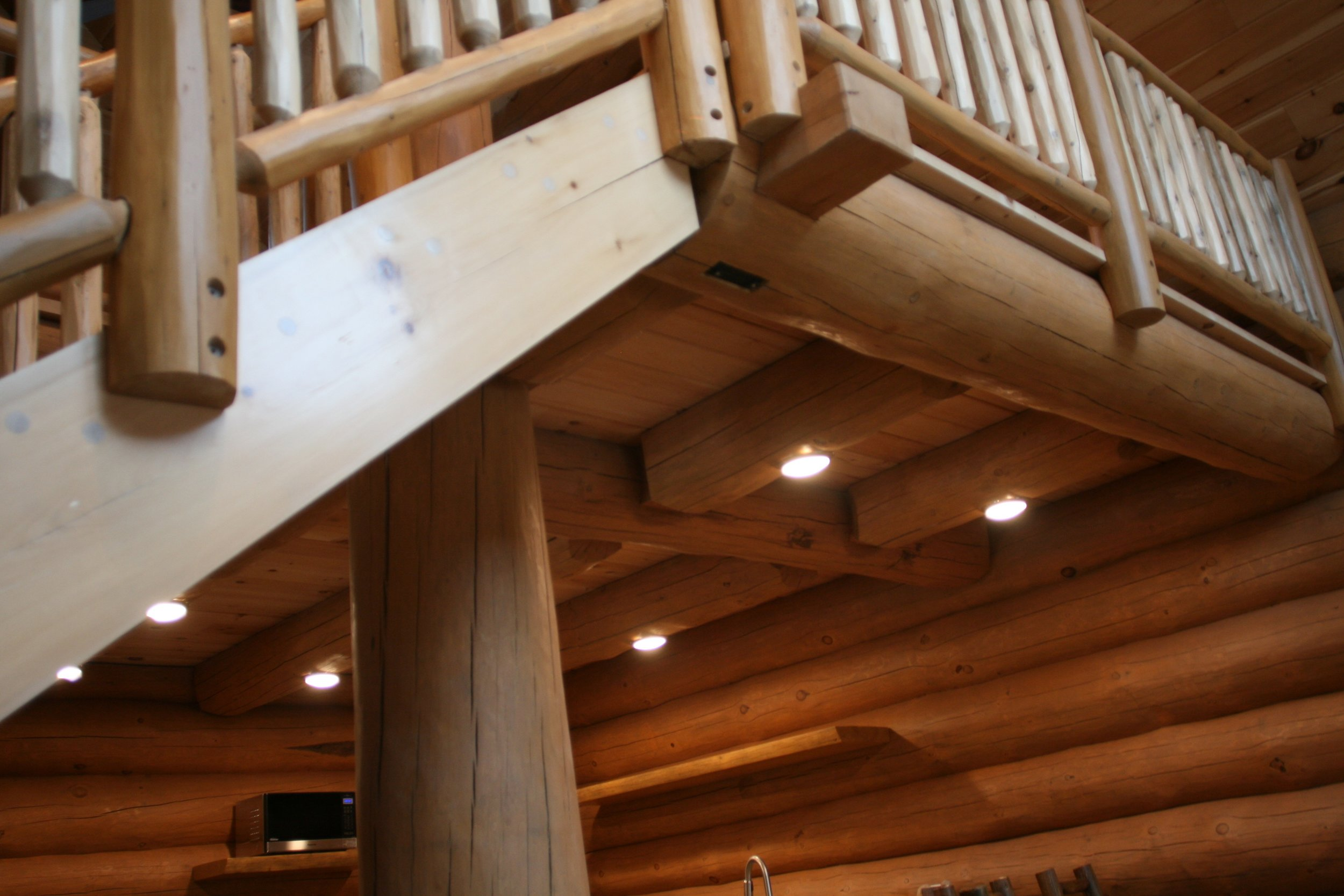 Log cabin loft. Log hand rails.