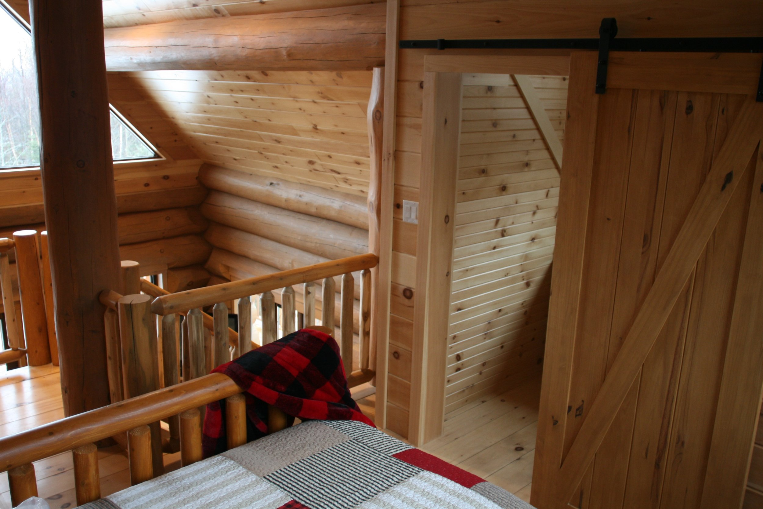 Log cabin loft bedroom